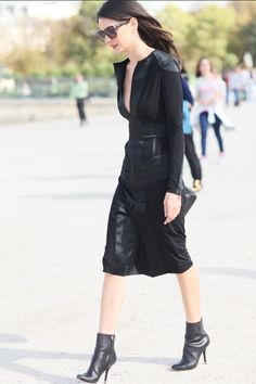 A slim leather-paneled dress and ankle boots made the coolest of combos.