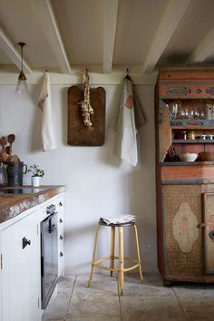 An eighteenth-century Norwegian dresser is used for storage and food preparation in the kitchen.