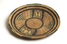 Coil leather and grass plate from Nigeria which dates from 1900 – 1917. This plate would have usually been used to present dry food but could also have been used as a lid to keep flies away. Charles Partridge Collection, World Collection, Ipswich.