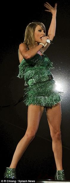 More conservative: TSwift also copied (while covering up a bit more) JLo's fringed green onesie as she performed during the opening ceremony of the 2014 FIFA World Cup Brazil on June 12, 2014