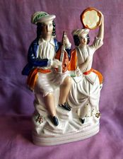 Victorian Staffordshire flatback of man and woman as musicians.