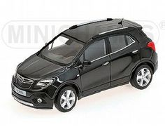 The Opel Mokka Black Metallic is a diecast model in 1/43 scale and is part of the Minichamps Road Car Collection.