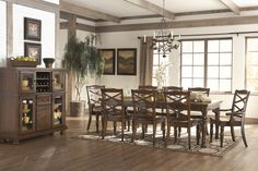 Bill and I are known to enjoy a glass (…or bottle) of wine with dinner. I am Italian, after all! As far as I'm concerned, no dining room is complete without somewhere to store the wine. | Porter Dining Collection | Ashley Furniture HomeStore