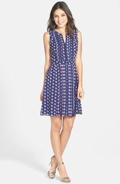 Free shipping and returns on Halogen® Pleated Fit & Flare Dress (Regular & Petite) at Nordstrom.com. A series of crisp pleats flank the center front and back of a sleeveless dress tailored in a classically feminine silhouette and topped with a split neckline.