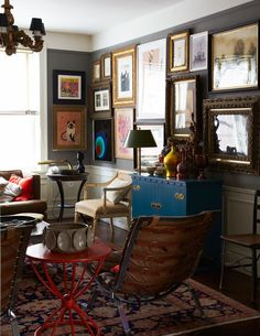 gallery wall, gold frames, vintage rug, lampshade, pops of color