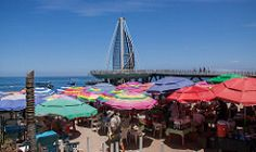 Beach Umbrellas and Boardwalk in Puerto Vallarta, Mexico (ChrisGoldNY) Tags: city urban latinamerica americalatina colors architecture poster mexico design colorful colours forsale jalisco mexican posters malecon beaches albumcover boardwalk vallarta puertovallarta bookcover colourful umbrellas bookcovers albumcovers licensing chrisgoldny chrisgoldberg chrisgold chrisgoldphoto chrisgoldphotos chrisgoldla