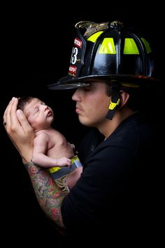 fireman baby picture...would work with a police officer too!!