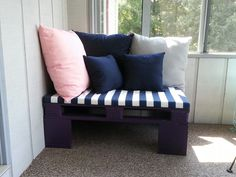My DIY pallet couch. I painted the pallet dark purple,  made the legs which are 2 square blocks nailed to a triangular base, and made the cushion and pillows with outdoor fabric