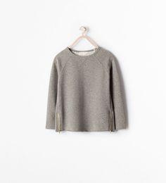 Image 1 of ZIPPED SHINY SWEATSHIRT from Zara