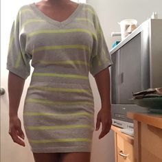 Express sweater dress Cute gray and lime green dress that falls above the knees.  This is a casual dress that gathers at the waist for a relaxed fit up top.  It does not have tags, but has never been worn. Express Dresses Mini