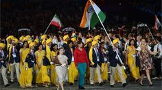 Sushil Kumar of the India Olympic wrestling team carries his country's flag during the Opening Ceremony of the London 2012 Olympic Games on 27 July.