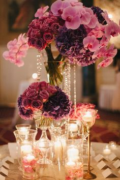 15 Stunning Orchid Themed Wedding Centerpieces. To see more: http://www.modwedding.com/2013/12/11/orchid-themed-wedding-centerpieces/