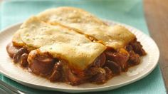 Chili-Cheese Dog Crescent Casserole  2 cans (15 oz each) chili with beans  8 hot dogs, sliced  1 1/2 cups shredded American cheese (6 oz)  1 can (8 oz) Pillsbury® refrigerated crescent dinner rolls or 1 can (8 oz) Pillsbury® Crescent Recipe Creations® refrigerated seamless dough sheet  1 tablespoon sesame seed