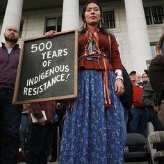 """500 Years of Indigenous Resistance!"" Activist Denae Shanidiin stands near Bears Ears National Monument, southeastern Utah, c. 2018.  Photo credit: Denae Shanidiin — at Bears Ears National Monument."