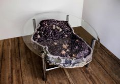 "Amethyst Cocktail Table will start the conversation over a truly wonderful piece from Nature's Jewel Box! The amethyst geode has lavender to purple crystals with very well formed pink calcite that appears ""sugar frosted"". The geode rests on a stainless steel frame."