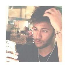 Does he have to be sexy even on the phone! :p