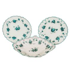 Two pairs of 18th century Chelsea Derby dishes (only one oval is shown) decorated with flowers painted in a wonderful intense blue green specific to Chelsea Derby. The edge of each dish is scalloped and decorated with a purple line under a turquoise line. The reverse of the dishes marked with an anchor in iron red.