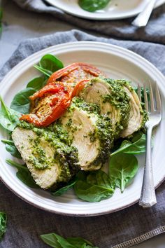 Easy one-pan Paleo pesto baked chicken that's seriously delicious, Whole30 friendly and great for weeknight dinners. Kid approved and ready in 30 minutes.