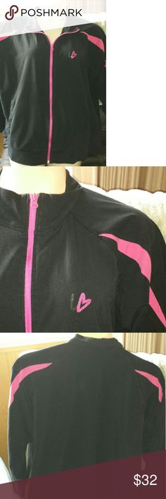 Plus size work out jacket by Lane Bryant Sporty and slightly understated this medium weight black workout jacket has hot pink accents, slash pockets and cuffed sleeves. Tags days size 24/26. Looks good on, in excellent used condition. Lane Bryant Jackets & Coats