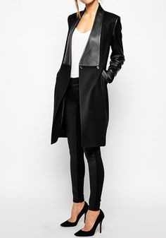 This black PU leather sleeve coat has that edgy, rock and roll flair.
