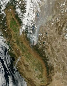 Rim fire, California        This natural-color satellite image of the drought-fueled Rim Fire was collected by the Moderate Resolution Imaging Spectroradiometer (MODIS) aboard NASAs Terra satellite on Aug. 25, 2013. The fire began on Aug. 17 and, as of Aug. 26, continues to burn on the Stanislaus National Forest, Yosemite National Park, and Bureau of Land Management and state responsibility land. Over 224 square miles have been affected.  Image credit: NASA/Jeff Schmaltz, MODIS Rapid…