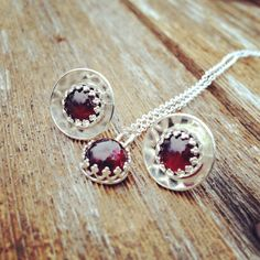 January Birthstone set of 6MM garnets are set in crown bezel to create a dainty stud earrings and pendant set. Garnets are a true deep maroon