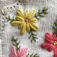 My Embroidered Sweater Project - Betz White Awhile ago I had seen a beautiful sweater that was inspired by a vintage cardigan. I decided to create my own version with wool embroidery. Diy Embroidery Flowers, Simple Embroidery Designs, Wool Embroidery, Hand Embroidery Patterns, Knitting Patterns, Embroidered Flowers, Free Knitting, Knitting Projects, Japanese Embroidery