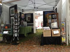 Art and craft show display for photos, prints, and cards.