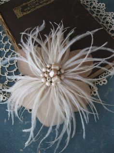 Gold Feather Flower with Blush Accents, Bridal Hair Flower, Wedding Head Piece, Vintage Pearls, via Etsy.