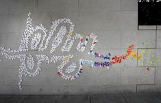 "Art group TheUpsideUp managed to combine street art, origami and typography. First spotted in San Francisco, on Asian Art Museum's exterior wall. 3-D art installation was thought to be the work of Parisian origami artist Mademoiselle Maurice ""mindful"" street art."
