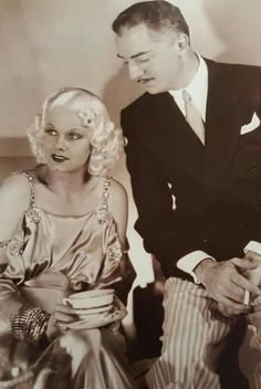 """Jean Harlow being visited by William Powell on the set of """"China Seas"""", 1935."""