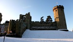 The East Front of Warwick Castle in the snow.