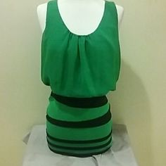 Dress A green and black dress, spandex like from the waist down. It's a large but can fit like a medium also, no stains or anything of that nature. AKIRA Dresses Mini