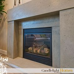 Contemporary and classic. This precast concrete fireplace brings a stylish touch to any space. Candlelight Homes. Utah Homes. Utah Builder. New Homes Utah. Home Decor. Interior Design. Design. Fireplace. Concrete. Concrete Fireplace. Home. Utah.