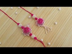 Easy and beautiful pearl &flower rakhi design for bhaiya and bhabhi Diy Crafts For Gifts, Hobbies And Crafts, Rakhi Bracelet, Handmade Rakhi Designs, Rakhi Making, Kids Blouse Designs, Pinterest Jewelry, Quilling Paper Craft, Art N Craft
