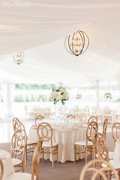Tented Wedding Lighting Ideas, Tented Wedding Reception Decor, Blush and Gold Tented Wedding | A Dreamy Winery Wedding with A Lush Floral Arbour | ElegantWedding.ca