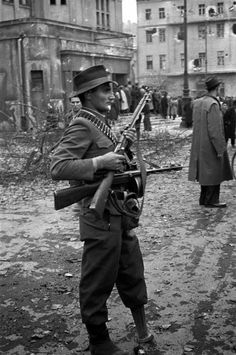 """Janos Mesz, also known as """"Janko of the wooden leg"""", one of the leaders of the rebel group Corvin Lane, stands at the Erkel Theatre on Koztarsasag Square during the 1956 insurrection in Budapest. Photo by Erich Lessing. Hungary Travel, My War, Unsung Hero, Army & Navy, Magnum Photos, My Heritage, Vietnam War, Eastern Europe, Historical Photos"""