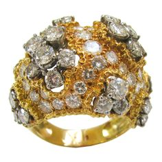 A French Diamond Gold Cocktail RIng | From a unique collection of vintage cocktail rings at http://www.1stdibs.com/jewelry/rings/cocktail-rings/