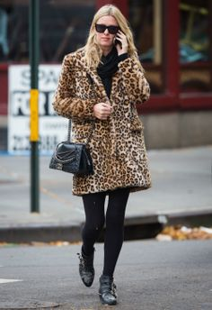 Nicky Hilton wearing  Chanel Fall 2013 Enchained Boy Bag