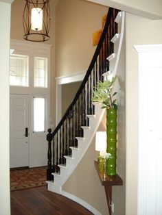 Painting the stair railing all black? Hmmmm maybe