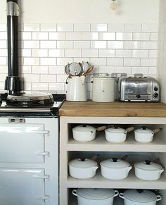 (image via lightlocations) love all those white pans and pots!