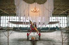 Such a unique #wedding ceremony backdrop...love it! From http://greenweddingshoes.com/whimsical-wedding-in-an-airplane-hanger-alex-keith/  Photo Credit: http://loveisabigdeal.com/ Venue: http://louisvilleexecutive.com/LEASpecialEvents.html