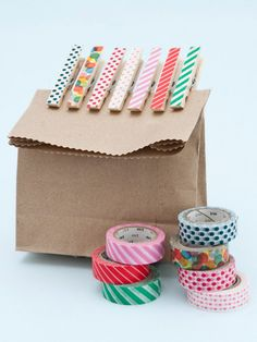 Cover clothes pins with Washi tape to close a gift bag. Works with binder clips as well