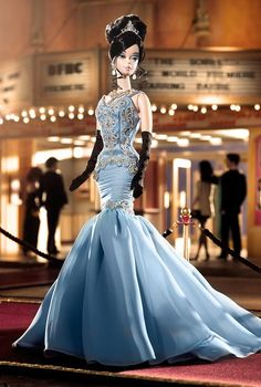 "The Soiree™ Barbie® Doll  Whether attending a Tinseltown gala, awards show or movie premiere, our striking starlet is a glamorous vision in blue. Dressed in an intricately detailed pale gown, complete with black opera-length gloves, statement-making ""jewels"" and a lovely updo, The Soiree™ Barbie® doll is as dramatic and dazzling as any real star in the sky!"