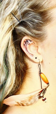 LOVE the inner ear tattoo!!! http://inkspire.awwomg.com/tattoodesigns/love-the-inner-ear-tattoo/