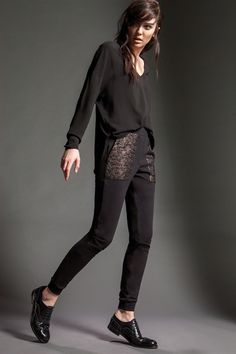 Model is wearing Naughty Dog FW15 black V neck blouse a pair of fleece pants decorated with precious lace details