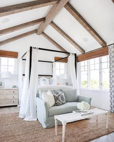 Canopy creates coziness in vaulted room (especially room shared with another bed) - couch or bench at the end maximized space