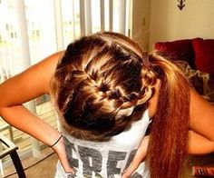 French braids swept in a ponytail