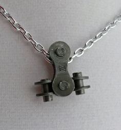 http://www.etsy.com/listing/72944356/bike-chain-upside-down-t-pendant?ref=correlated_featured