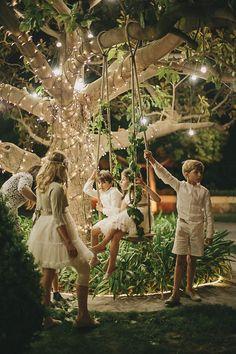 Children on a Fairy light garden swing / www.deerpearlflow...